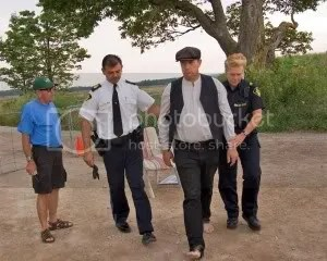 Farmer Michael Schmidt arrested by police for blocking gate at dump site 41. Photo by Robert Preston.