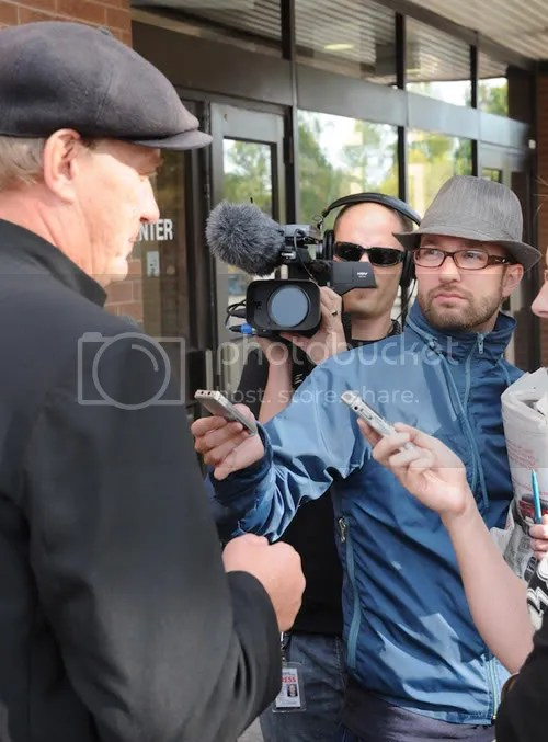 Sept 11, 2008, outside the Ontario Superior Court of Justice in Newmarket, Raw milk farmer Michael Schmidt answers questions from Toronto Sun reporter Brett Carlson. And thats Randy Riesling of Star Media behind the camera. Sun reporter Brett Carlson was later called to the stand by the prosecution lawyer to testify about what Michael Schmidt had told him in interviews.