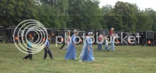Children walk past Amish parking lot. Photos Wayne Herrod