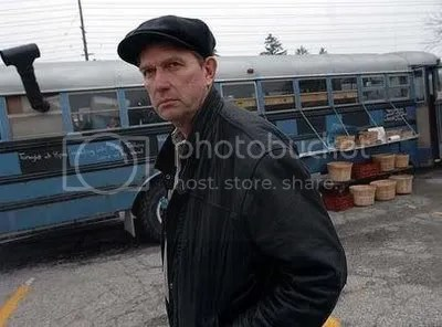 Michael Schmidt outside the blue bus. Toronto Star photo