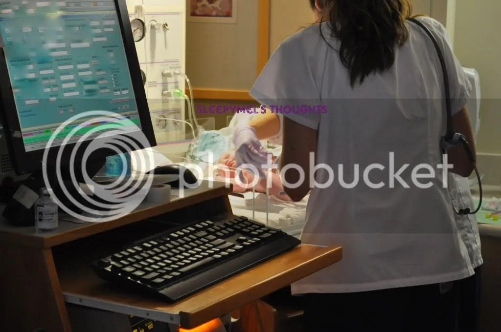 Nurses checking baby