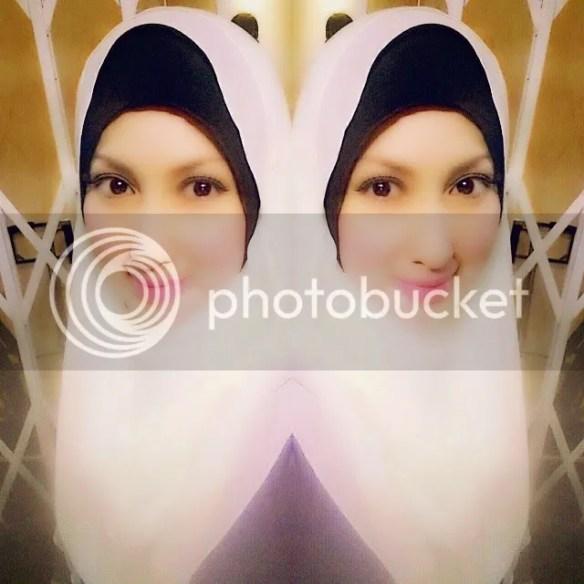 photo Gambar-Maria-Farida-Bertudung.jpg