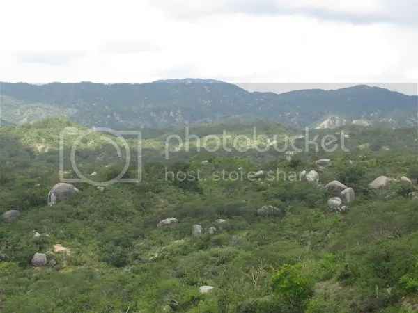 Boulders and hills as seen from a crest in the road before reaching Arroyo El Chayo