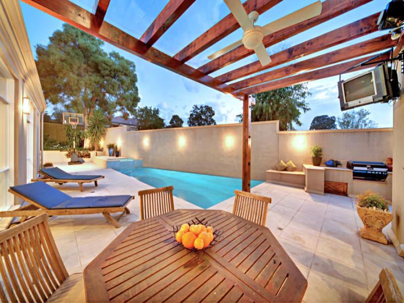 Indoor-outdoor outdoor living design with pool ... on Fancy Outdoor Living id=39520