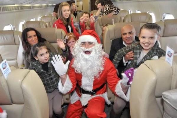 Santa Claus surprises children on exclusive flight from ...