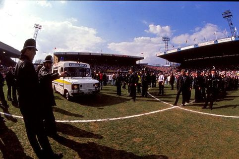 Police and an ambulance on the pitch at Hillsborough