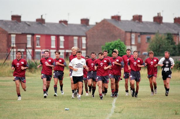 Fergie at pre-season training in 1995 with Gary Pallister (left), David Beckham and Steve Bruce