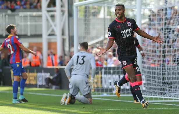 Steve Mounie of Huddersfield Town celebrates after scoring a goal to make it 0-3