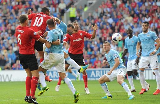 Fraizer Campbell scores the third goal for Cardiff