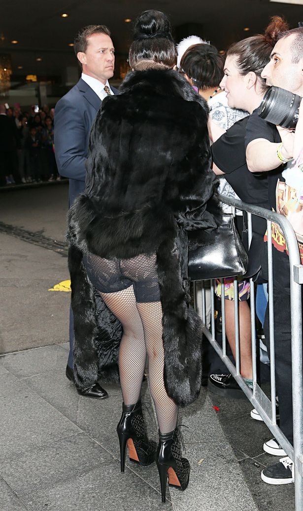 Attention Seeking Lady Gaga Flashes Her BUM In White