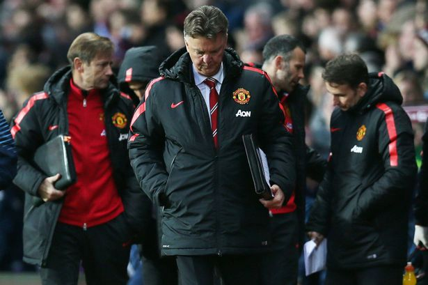 Manchester United manager Louis van Gaal looks dejected at half time