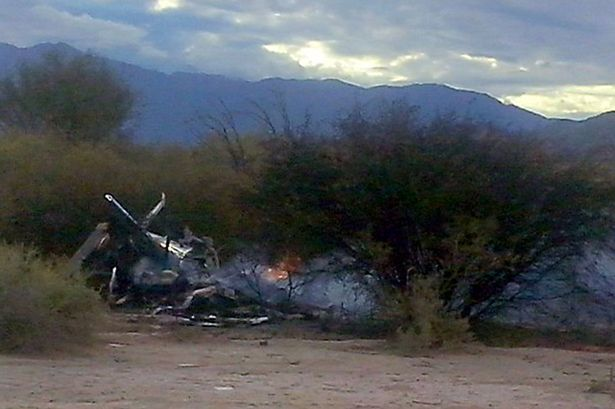 Picture of the burning wreckages of two helicopters which collided mid-air near Villa Castelli, in the Argentine province of La Rioja