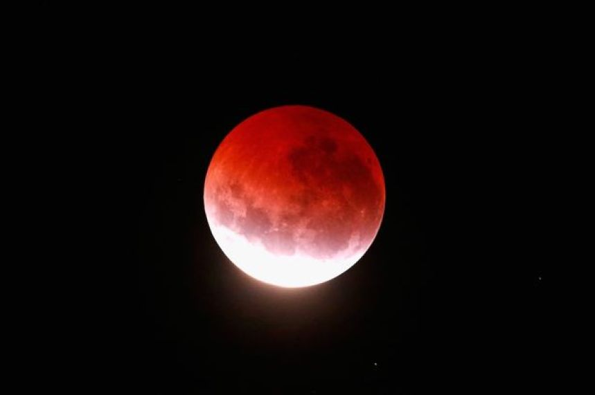 A blood red moon lights up the sky during a total lunar eclipse on April 4, 2015 in Auckland, New Zealand