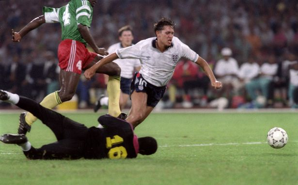 Gary Lineker is tripped by Cameroon's goalkeeper Thomas N'Kono during the World Cup quarter-final match in Naples