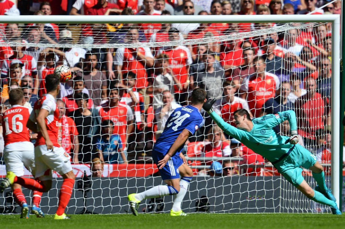 Thibaut Courtois cannot stop the shot from Alex Oxlade-Chamberlain giving Arsenal the lead