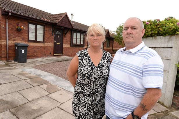 Gary and Joan are pictured outside their bungalow, in Southport Lancashire