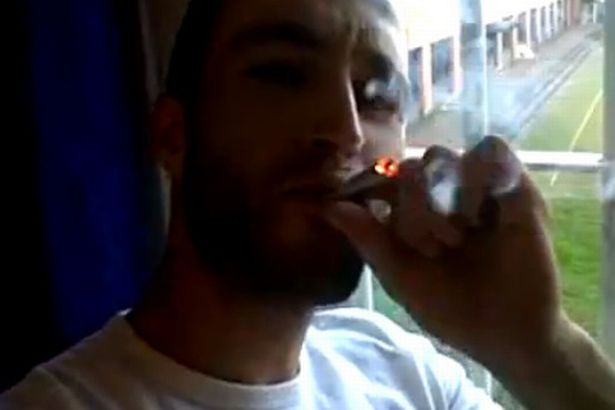 Man smoking weed in prison and showing off his life of luxury