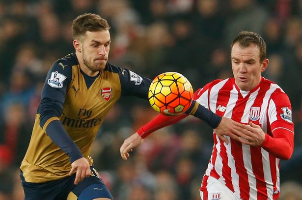 Aaron Ramsey in action with Glenn Whelan