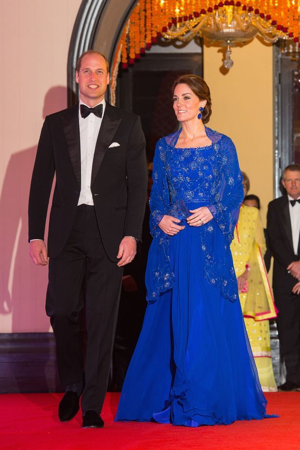 Kate Middleton wore a floor-length cobalt blue Jenny Packham dress for a Bollywood gala while Prince William wore black tie