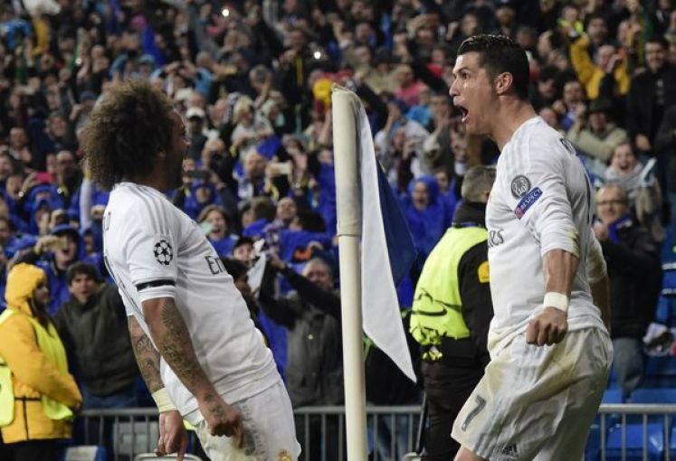 Real Madrid's Cristiano Ronaldo and Real Madrid's Marcelo celebrate after scoring a goal