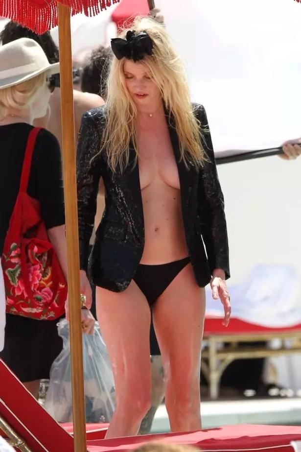 Super-model-Lara-Stone-photoshoot-on-the-beach-in-Miami-Beach 18+: Lara Stone flashes her B**b$ in racy bikini shoot