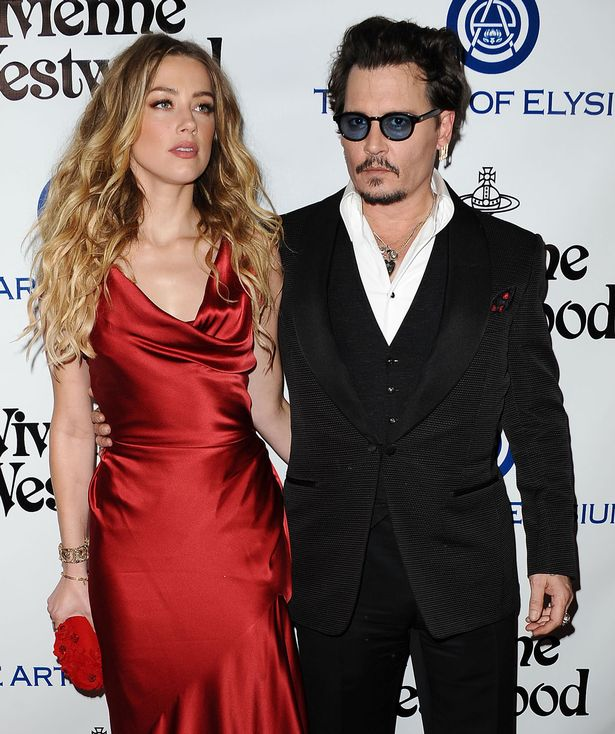 Amber Heard and Johnny Depp attend Art of Elysium's 9th annual Heaven Gala