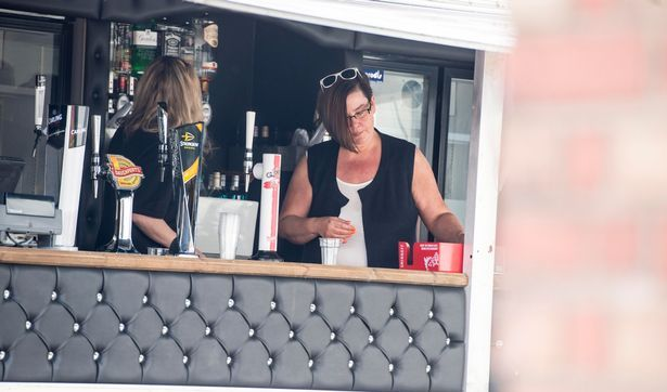 White Dee seen working a mobile bar