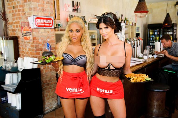 "Model Micaela Schaefer (R) and singer Sarah Joelle Jahnel (L) pose in a ""Naked-restaurant"