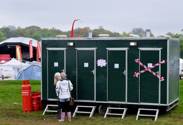 Leon Jackson uses shower block as a changing room at Kedlesston Park during Bearded Theory Festival 2012