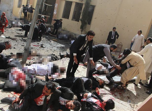 Lawyers help their injured colleagues after a bomb explosion in restive Quetta, Pakistan
