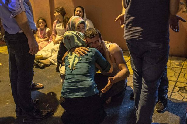 Relatives grieve at hospital August 20, 2016 in Gaziantep following a late night militant attack on a wedding