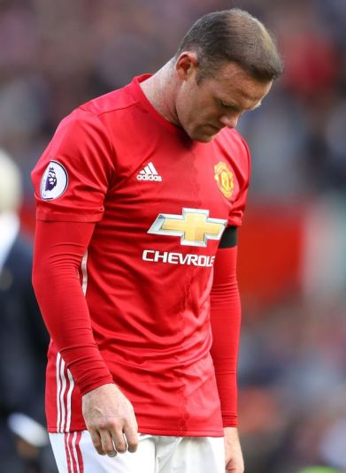 Wayne Rooney shows dejection after the final whistle