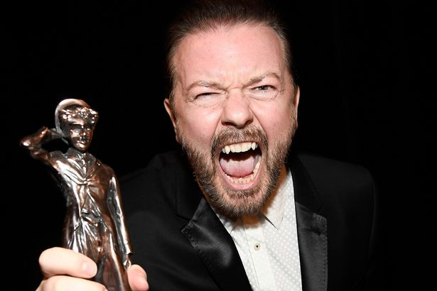 Honoree Ricky Gervais poses with the Charlie Chaplin Britannia Award for Excellence in Comedy