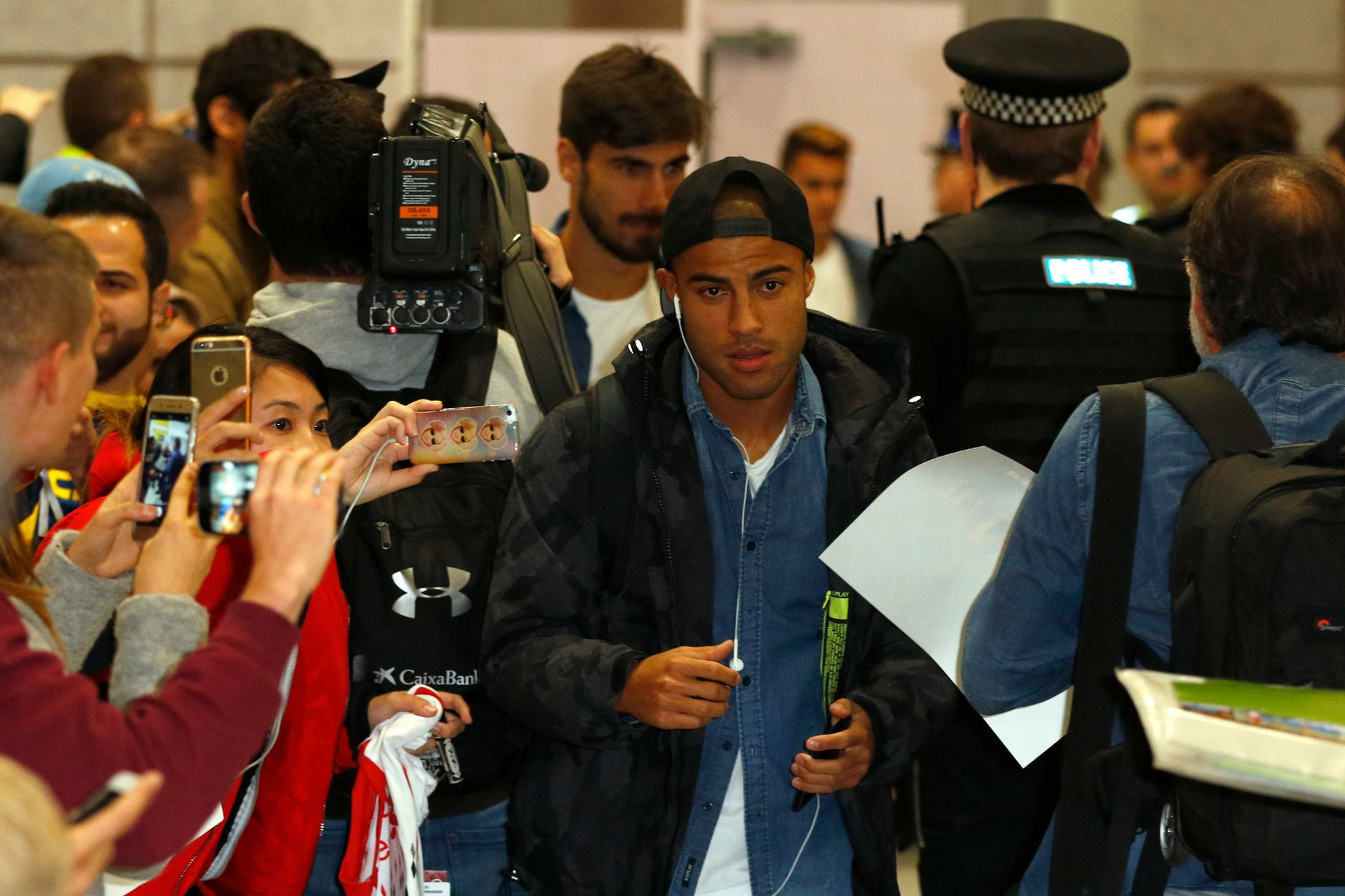 Rafinha arrives at Manchester Airport