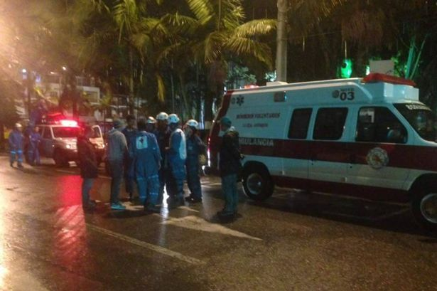 Emergency services near a scene of a plane crash close to Medellin