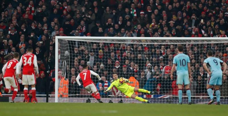 Alexis Sanchez scores from the penalty spot