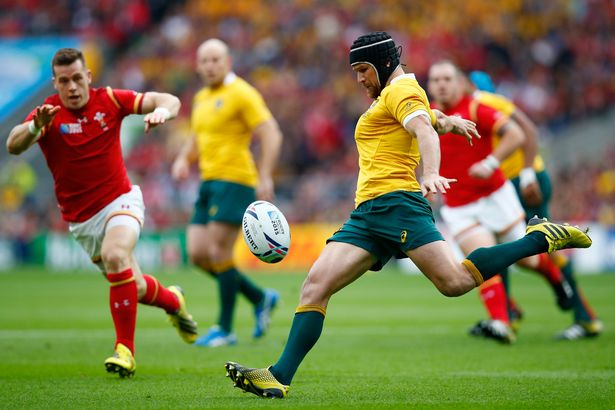 Matt Giteau of Australia kicks down field