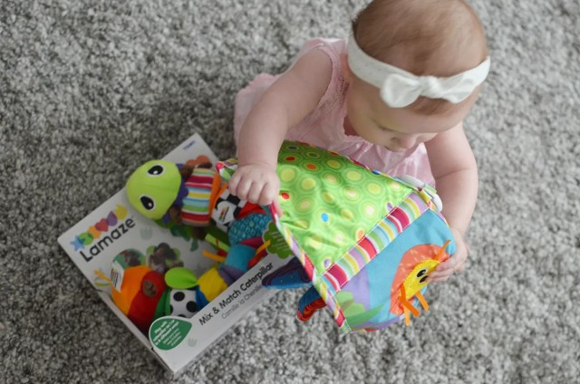 Lila plays and learns with Lamaze toys