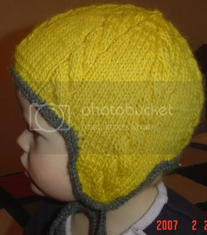 cabled hat with ear flaps