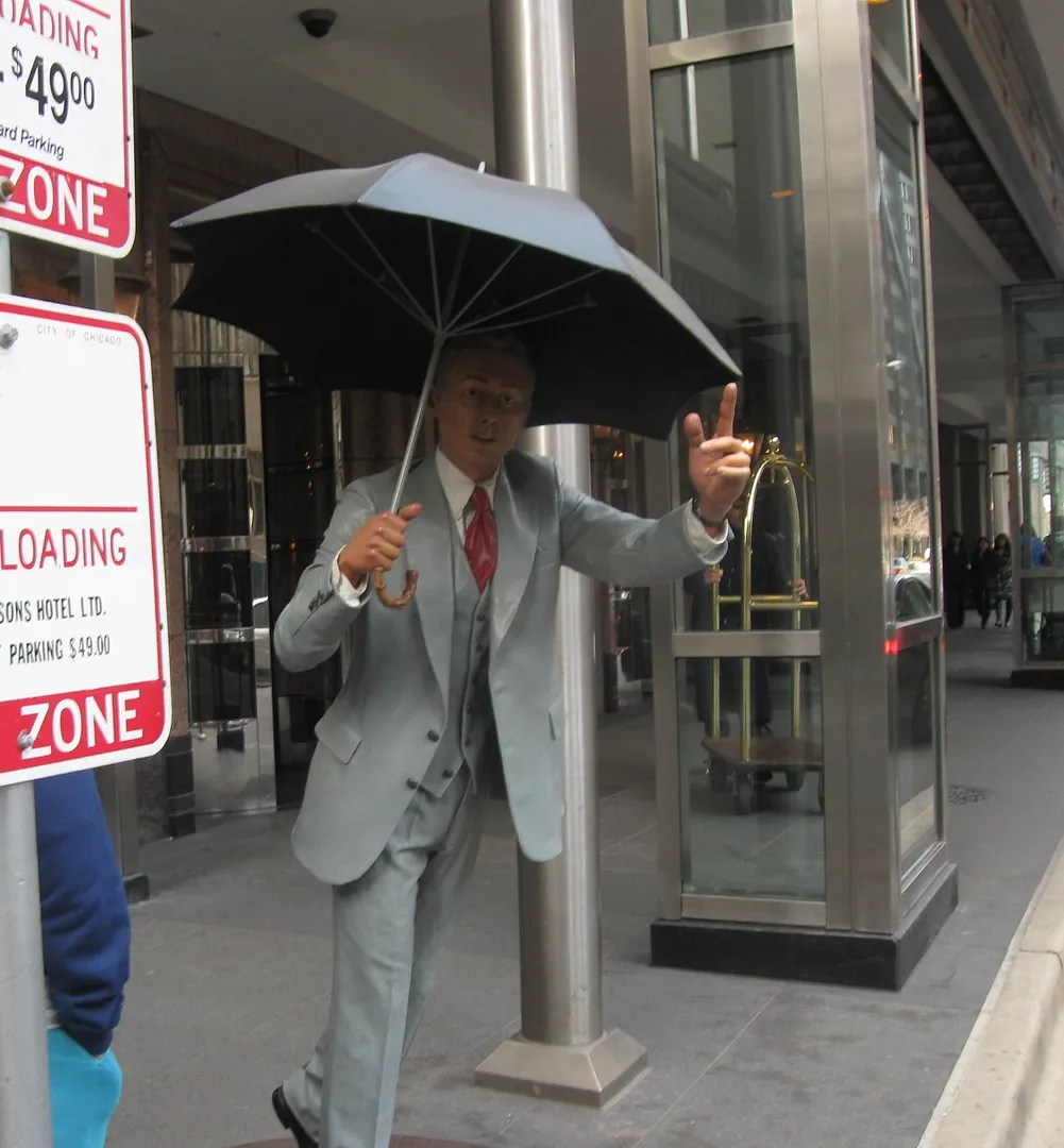 Four Seasons guy hailing cab statue, Magnificent Mile, Chicago