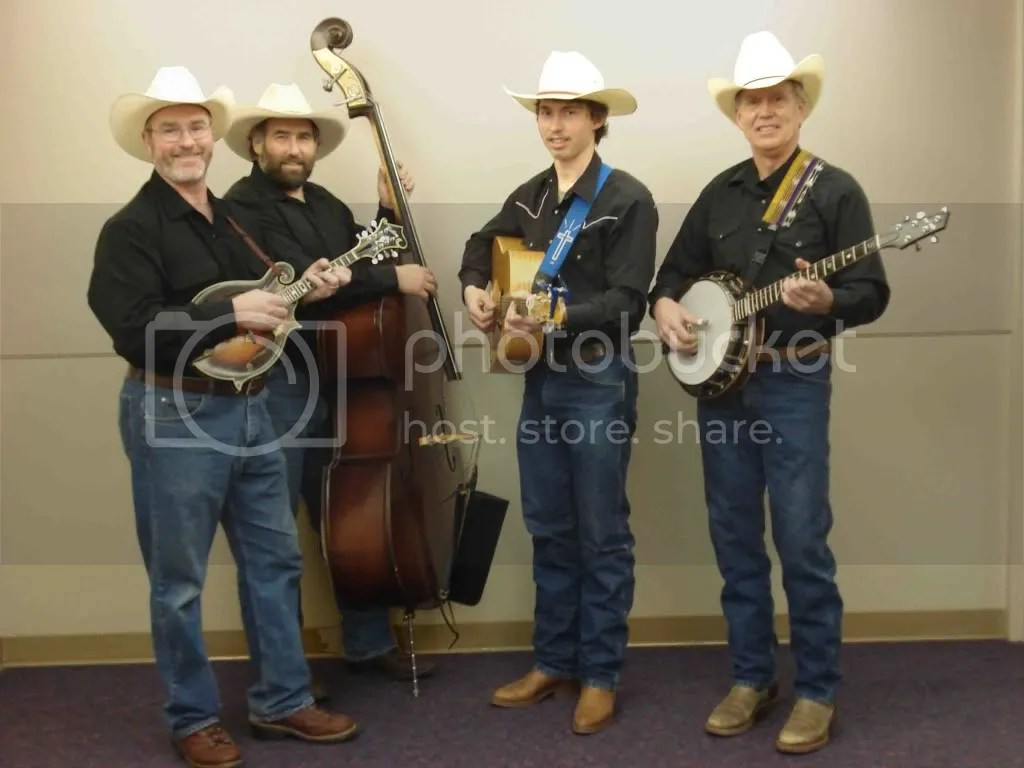 A tradional bluegrass band. Guitar, upright bass, banjo, mandolin, and no black people.