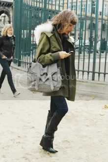 Vanessa Traina carries the PS1 in Paris
