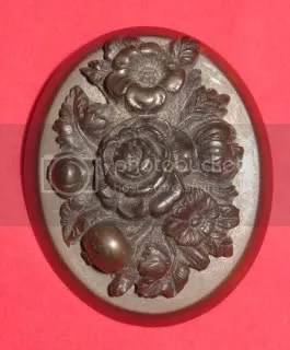 ABOVE: a Victorian mourning flower brooch made from Vulcanite. The types of flowers shown here would have had great meaning to the original owner.