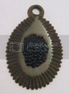 ABOVE: This Victorian pendant is made from a Vulcanite base, while the grapes are made from French Jet, which is a fancy term for black glass. Grapes symbolise charity.
