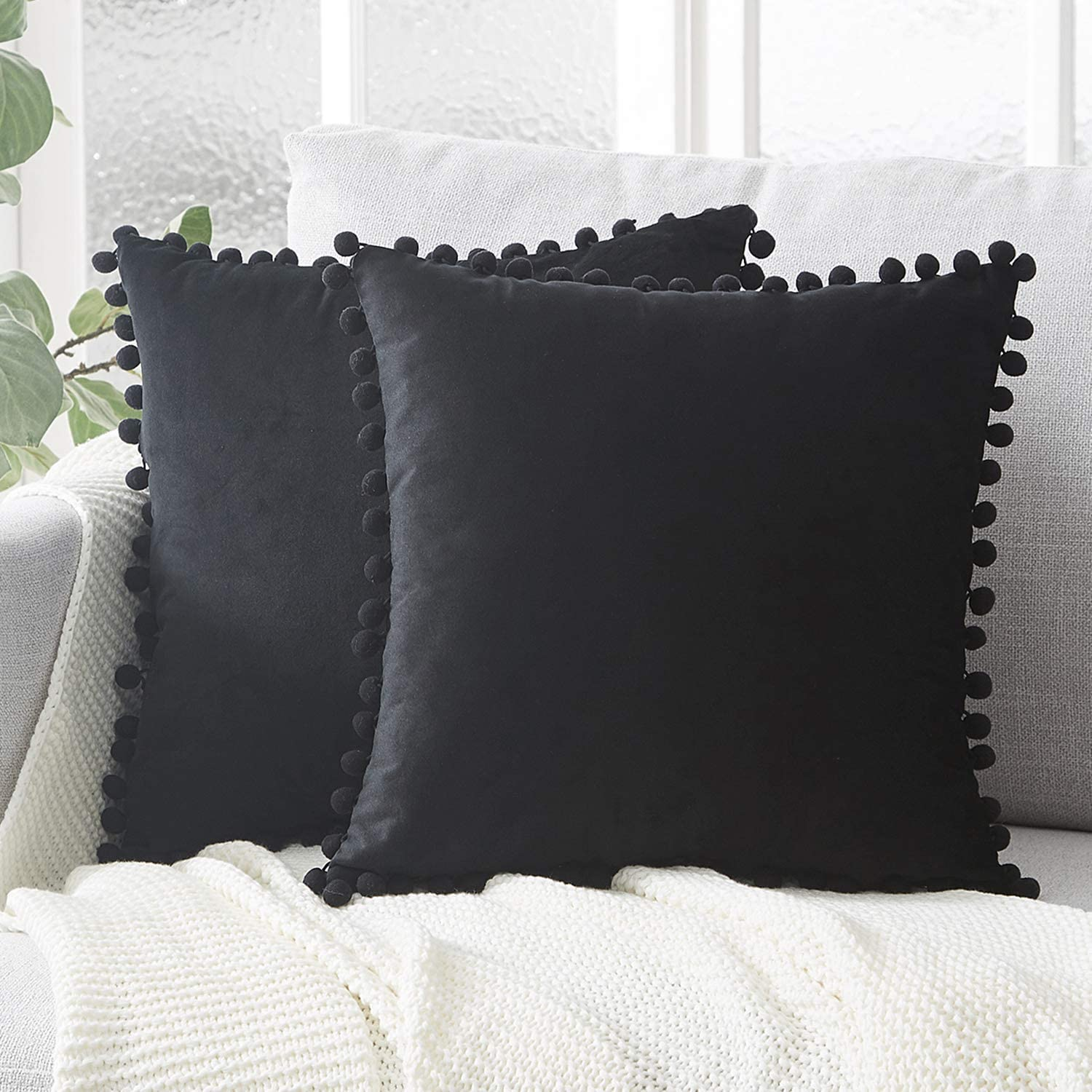 topfinel solid decorative throw pillow covers with pom poms square soft velvet cushion covers 24 x 24 for bohemian home decor pack of 2 black