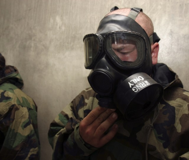 A Field Radio Operator Clears Cs Gas From His Gas Mask At The Gas Chamber Canvas