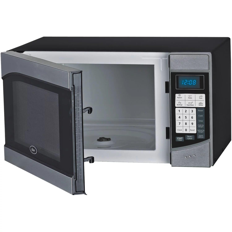 https www walmart com ip oster compact size 0 9 cu ft 900w countertop microwave oven with stainless steel door trim 21783827