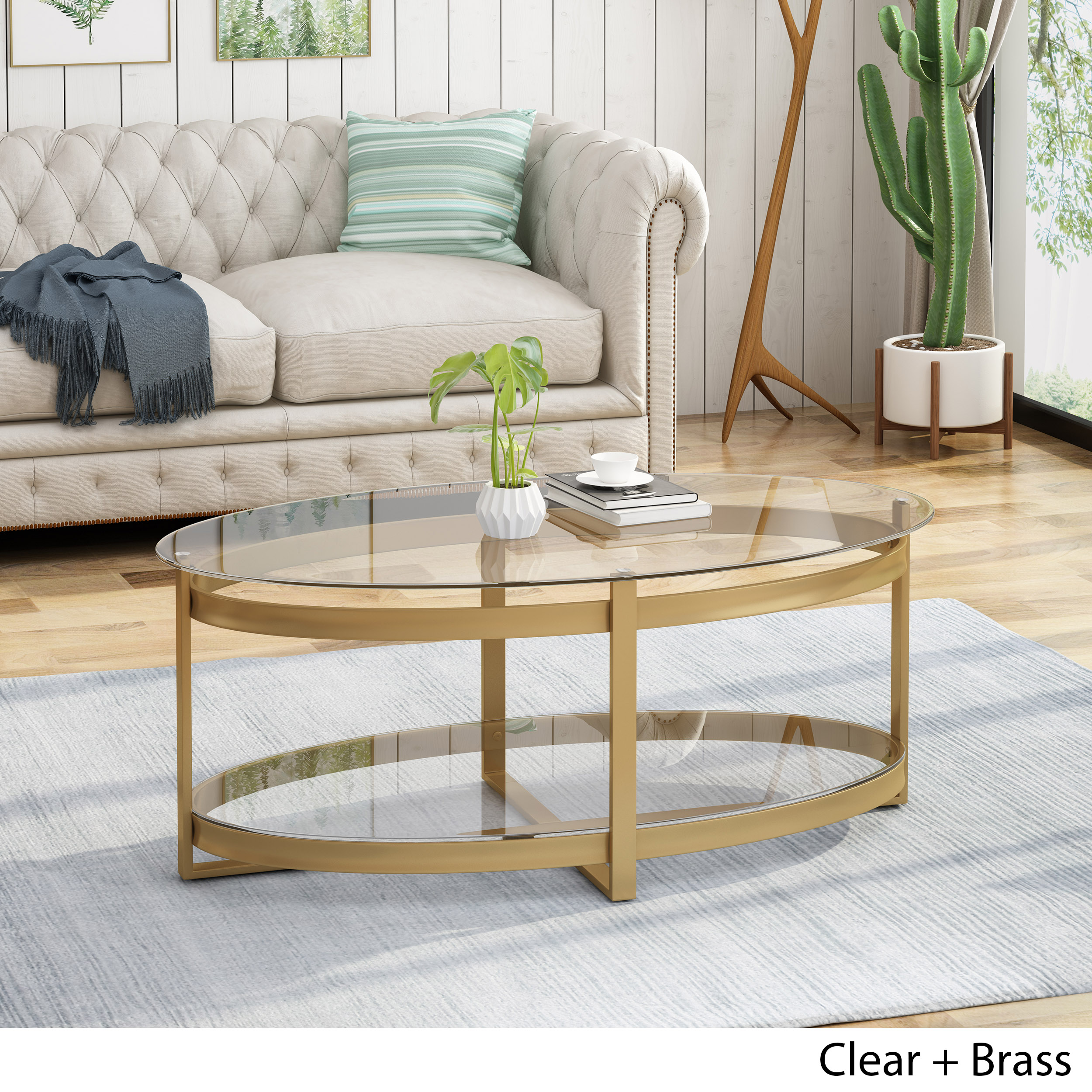 bell modern glam tempered glass oval coffee table with iron frame brass finish