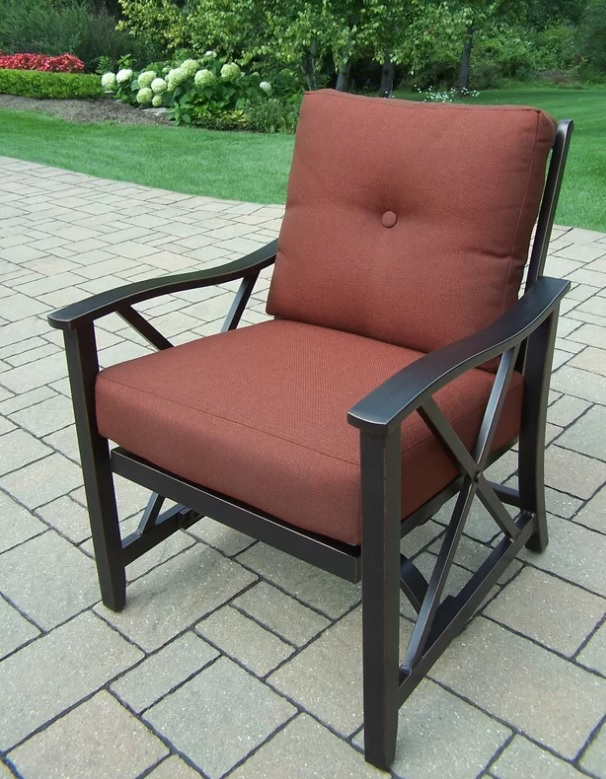 bronze outdoor patio seating rocking chair red cushions