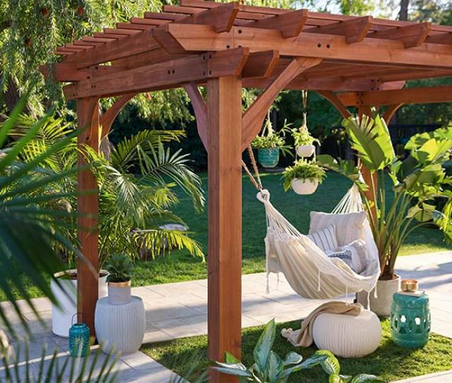 Borrow The Effortless Chic Of A Mediterranean Garden With A Wooden Pergola